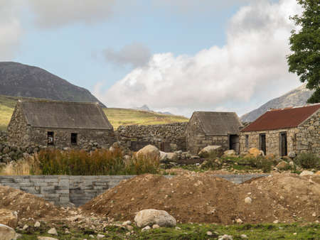 a couple of old farm out buildings close to the mourne mountains in Ireland Stock Photo