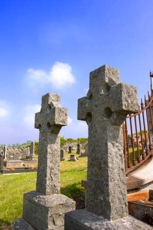 2 irish celtic crosses in an old grave yard