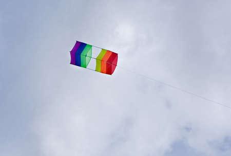 box kite flying high against blue skies