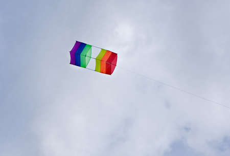 box kite flying high against blue skies