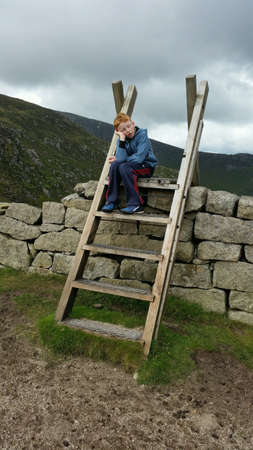 Boy having a nap after climbing in mournes ireland Stock Photo