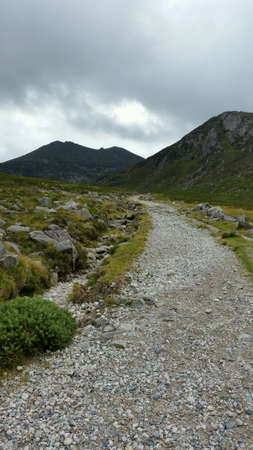 Path in mournes looking at slieve bernagh mournes ireland Stock Photo