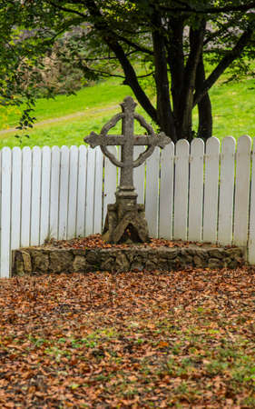 An old Irish cross with leaves Stock Photo