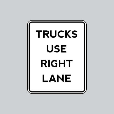 use: Trucks use right lane road sign