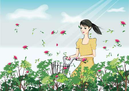 Mujer que monta la bicicleta en el jardín de flores