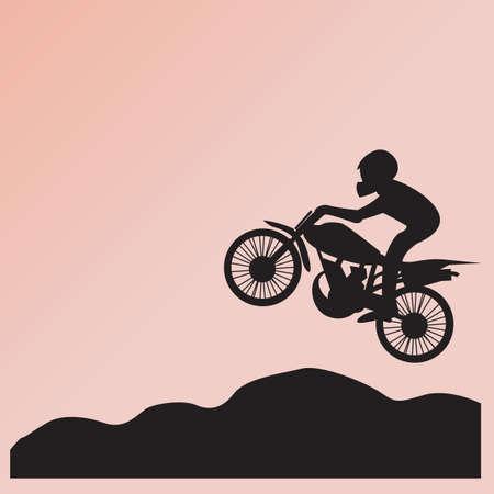 midair: silhouette of man on bike in mid-air