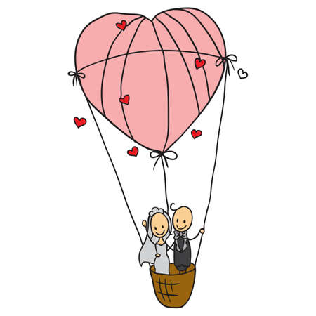 heart shaped: wedding couple in a heart shaped air balloon