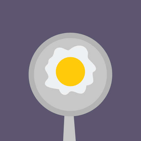 fried egg: fried egg on cooking pan