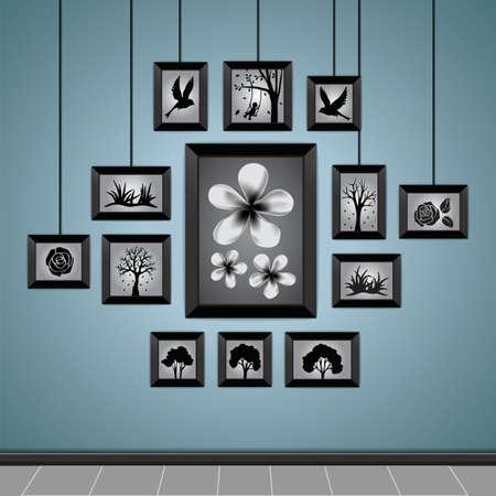 marcos de fotos en una pared