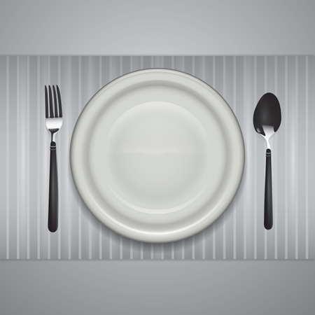 a plate with a fork and spoon