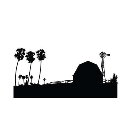 silhouette of farmhouse with a windmill