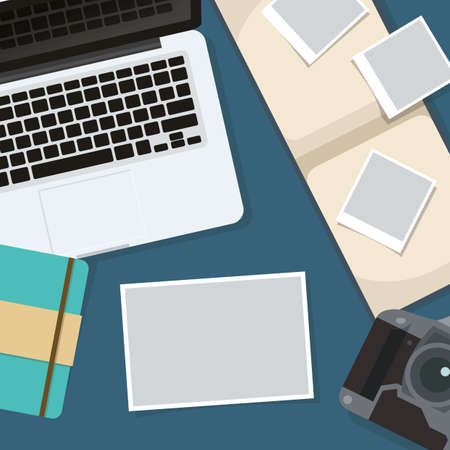 Flat lay of laptop with photographs.