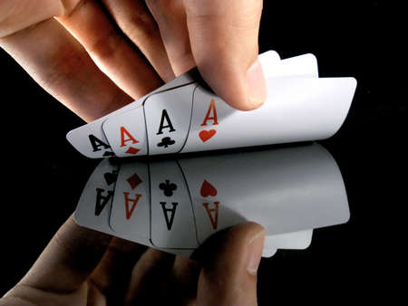 card player: Four aces in the hands