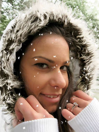 Snow falling over the face photo