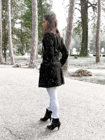 Girl walking through the park photo