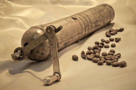 Hand mill for coffee and coffee beans on the silk photo
