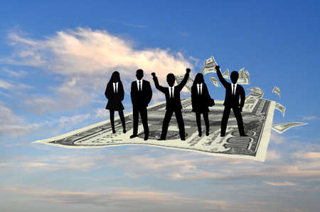 Business team flying on the hundred dollars banknote photo