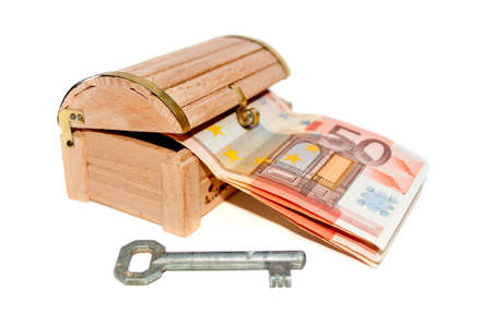 Fifty euro banknotes in the wooden chest and key isolated on white Stock Photo - 9068350