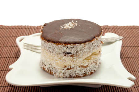 Russian cap cream-cake decorated with coconut photo