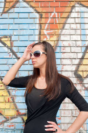 Girl with glasses in front of a wall with graffiti Stock Photo - 9240015