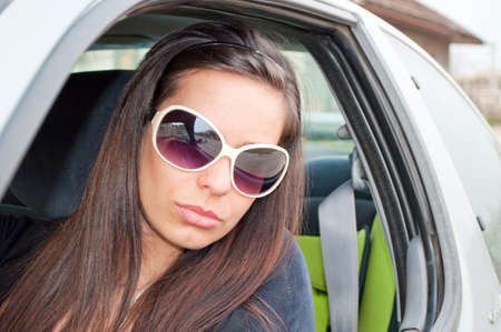 Brunette girl looking through car window Stock Photo - 9239985