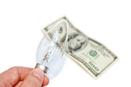 Hand holding bulb and fifty-eurohundred-dollars bill in the background  photo