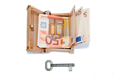 Euro banknotes in the treasure chest and old key - bird's eye view Stock Photo - 9326878
