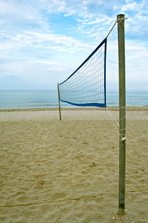 Lonely volleyball net on the beach photo