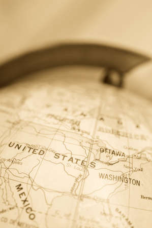 Focus on the USA on the globe - sepia toned image photo