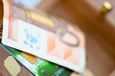 Credit card and money in the wooden chest photo
