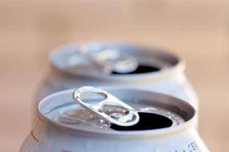 Close up of a two opened cans photo