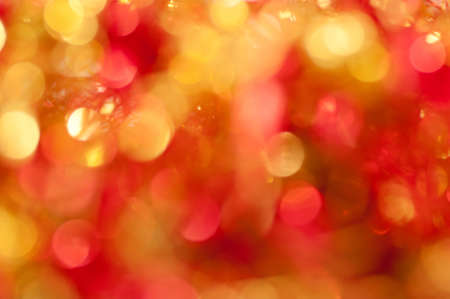 Christmas blurred background make from red-golden garland and defocused photo