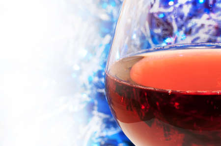Red wine, decorative ribbon in the background and copy-space on the left side Stock Photo - 10513241