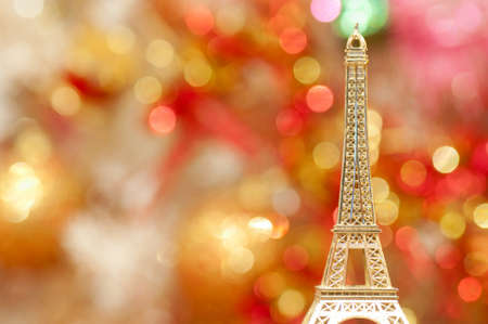 Model of the Eiffel tower and abstract bokeh background photo