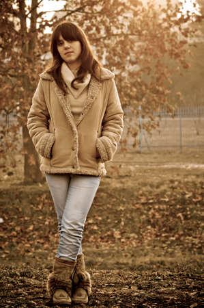 Young brunette posing in the nature at autumn photo