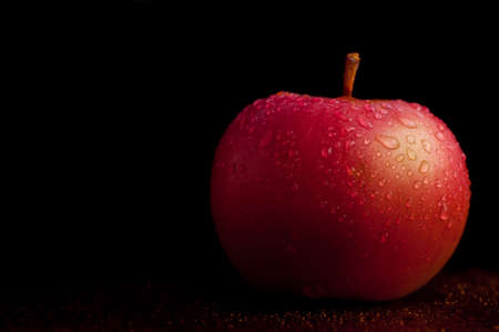bright red: Wet apple with black background Stock Photo