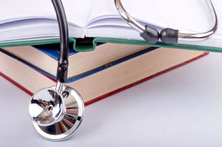 Close-up of the stethoscope on the books photo