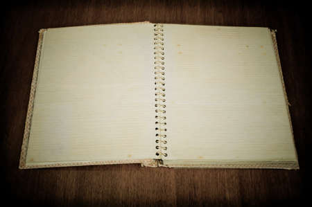 Blank old photo album on the wooden table photo