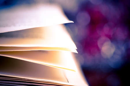 Few pages of open book and bokeh effect in the background photo