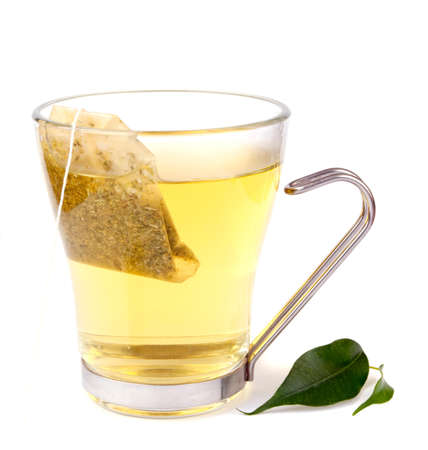 Transparent tea cup with bag isolated on white
