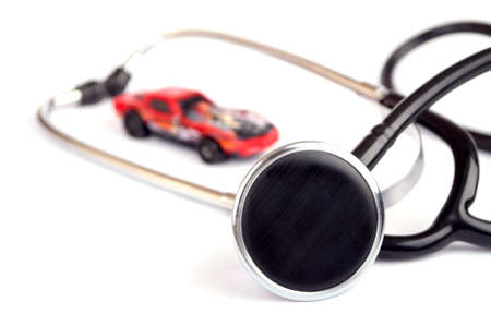 bugging: Stethoscope and small car toy isolated on white - car service