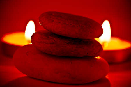 Pile of stones and blured candles in the background photo