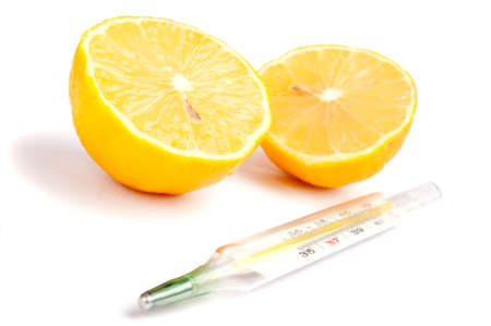 Close-up of thermometer and two lemon half, isolated on white photo
