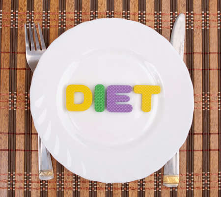 Letters made word Diet on the plate photo