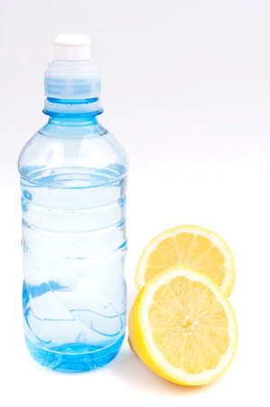 Bottle of water and two halves of lemon photo