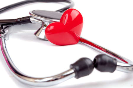 Decorative heart and stethoscope isolated on white photo