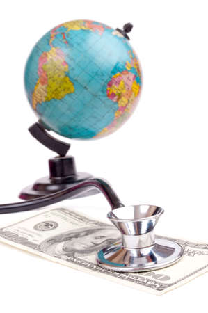 Stethoscope on the hundred-dollar bill and globe in the background - travel insurance concept photo