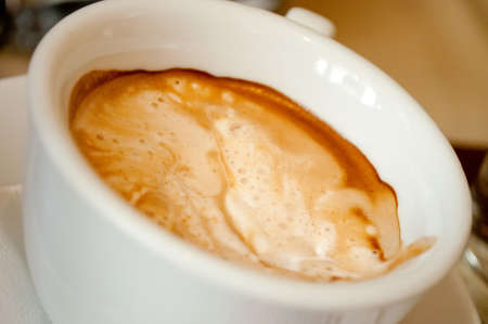 Close-up shot of the espresso foam in the white cup Stock Photo - 13013577