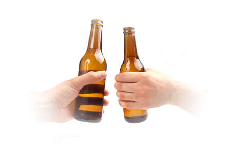 Two hands and two bottles of beer, isolated on white photo