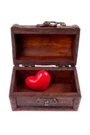 treasure box: Decorative heart in the old wooden chest, isolated on white